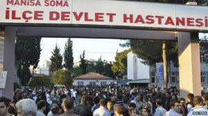 Crowds gather outside Soma's local hospital
