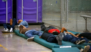 NOGALES, AZ - JUNE 18:  Young boys sleep in a holding cell where hundreds of mostly Central American immigrant children are being processed and held at the U.S. Customs and Border Protection Nogales Placement Center on June 18, 2014, in Nogales, Arizona.  Brownsville, Texas, and Nogales, have been central to processing the more than 47,000 unaccompanied children who have entered the country illegally since Oct. 1. (Photo by Ross D. Franklin-Pool/Getty Images)